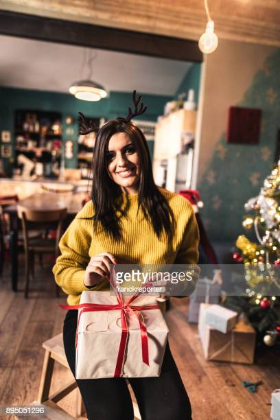 woman showing the christmas gift at home