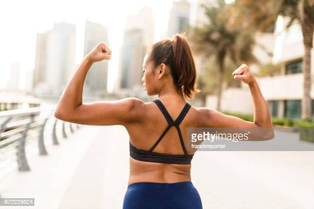 woman showing the muscle - flexing muscles stock pictures, royalty-free photos & images
