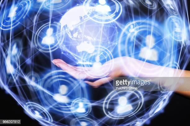 Woman showing virtual global network
