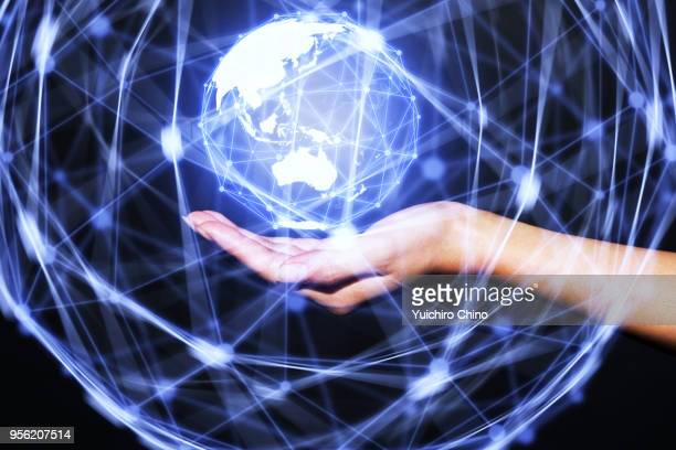woman showing virtual global network - hud graphical user interface stock photos and pictures