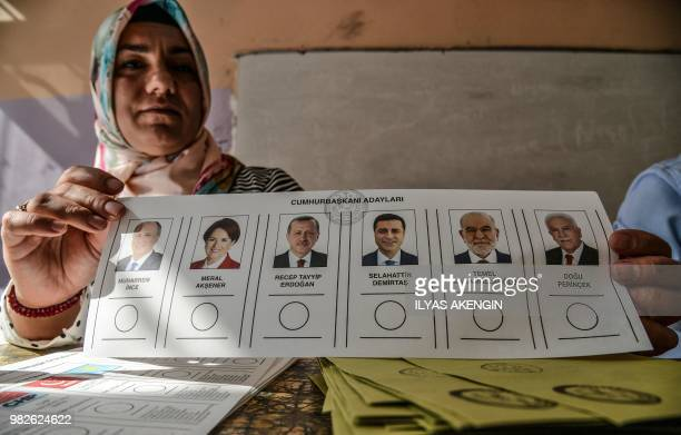 A woman shows a ballot paper at a polling station in snap twin Turkish presidential and parliamentary elections in the Kurdish stronghold of...