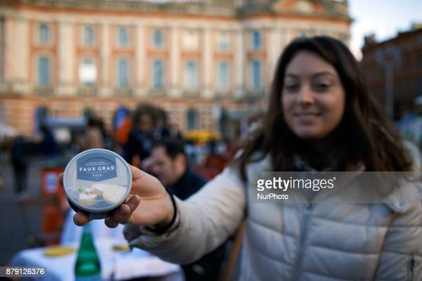 A woman shows a can of vegetal 'foie gras' The L214 association did a 'speeddating' about foie gras to have people try false 'foie gras' on the main...