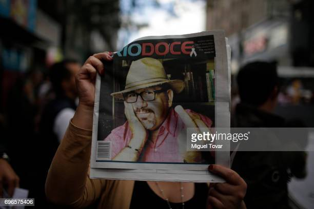 A woman shows a newspaper with murdered journalist Javier Valdez in the front page during a demonstration to end violence against journalists in...