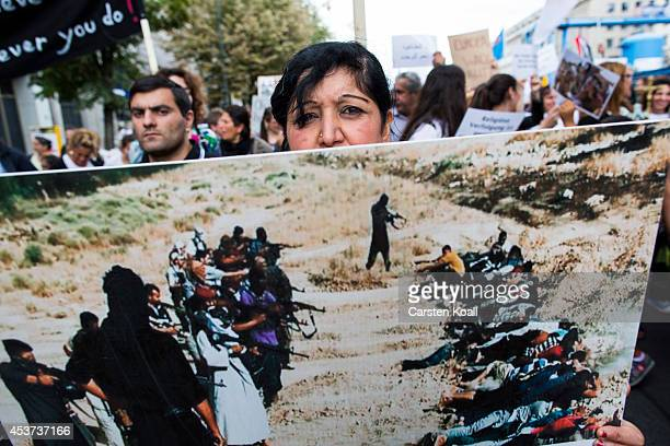 A woman shows a photograph as more then thousand participants of several oriental christian groups gather to protest against the ongoing violence...
