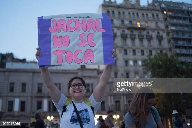 Woman shows a placard in defense of the Law of Glaciers that is being modified to favor the mining companies the Assembly of Jachal in the province...