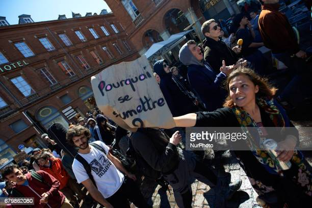 A woman shows a placrd reading 'Why submit ' during a musical wander organized by a choir and an orchestra It took place in Toulouse before the...