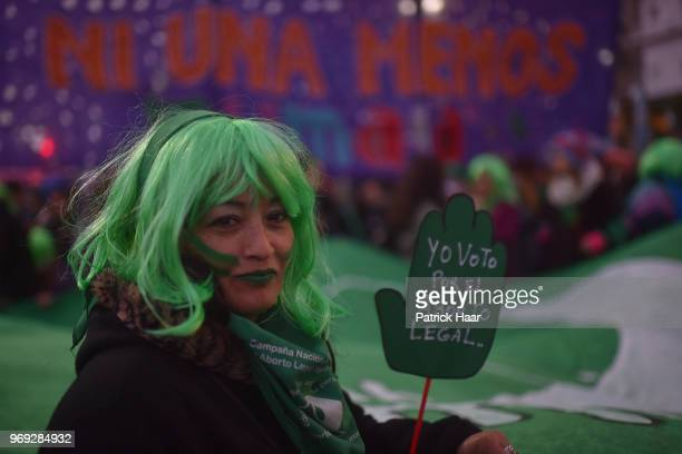 A woman shows a sign that reads 'I vote in favour of legal abortion' during a protest as part of the 'Not One Less' movement demanding legal abortion...