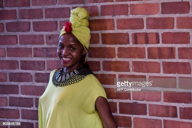 A woman shows an AfroColombian hairstyle during the 13th contest of Afro hairdressers Tejiendo Esperanzas in Cali Valle del Cauca department Colombia...