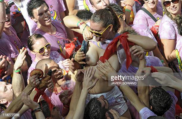 Woman shows her breast while celebrating during the 'Chupinazo' to mark the start at noon sharp of the San Fermin Festival on July 6, 2011 in front...