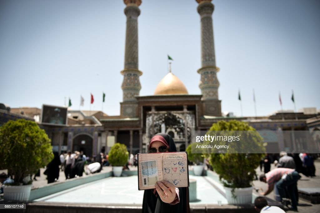 A woman shows her identity as she waits to cast his ballot during Iran's 12th presidential election, at Shah Abdol Azim mosque in Tehran, Iran on May 19, 2017.