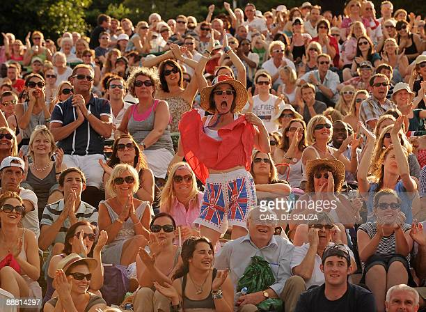 A woman shows off a pair of bloomers featuring Britain's Union Jack flag as she watches Britain's Andy Murray play against Andy Roddick of the US on...