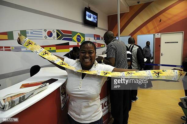 A woman shows official 2010 FIFA World Cup tickets she just purchased on April 15 2010 at the Maponya shopping mall in Soweto during the first day of...