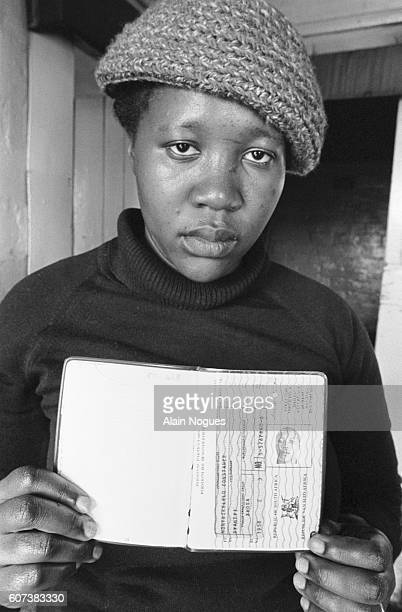 A woman shows the interior passport that she must have to enter Cape Town during work hours The rest of the time blacks are not allowed in the cities