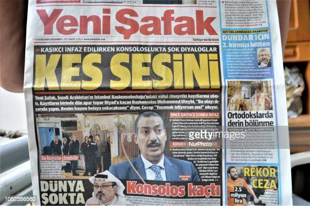 A woman shows Yeni Safak a Turkish progovernment daily newspaper as the daily runs a headline on its front page that reads 'Shut up' with a picture...