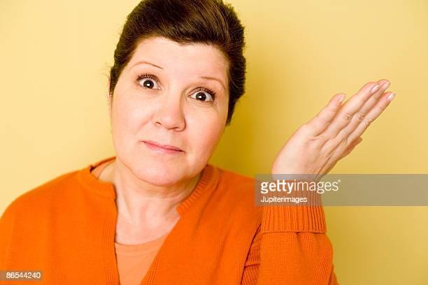 Woman shrugging shoulder