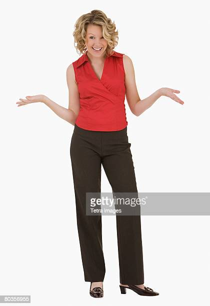 woman shrugging shoulders - arms outstretched stock pictures, royalty-free photos & images