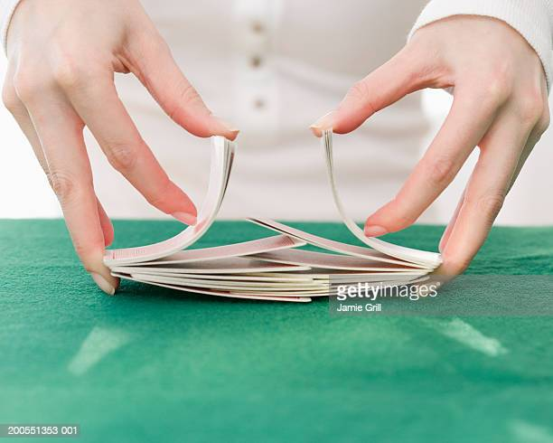 woman shuffling deck of cards, close-up - shuffling stock photos and pictures