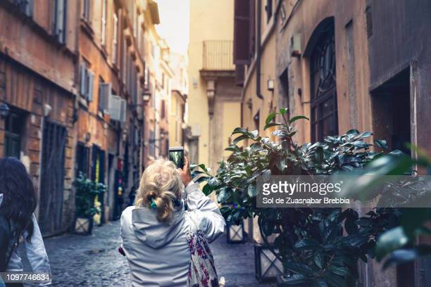 Woman sightseeing and photographing the streets of the city