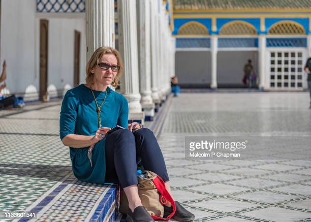 woman sightseeing in marrakesh, morocco - north africa stock photos and pictures