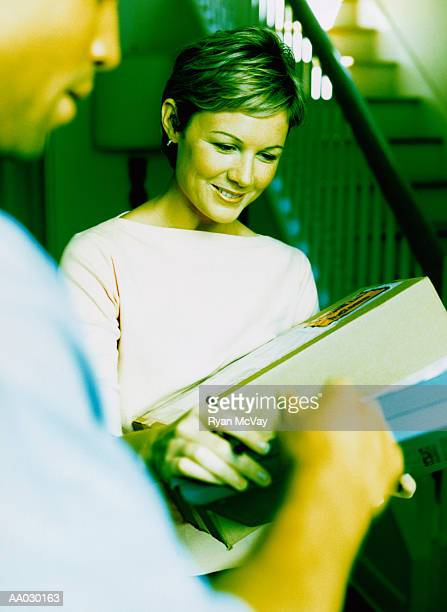 Woman Signing for Package at Home