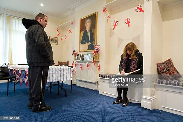 A woman signs a book of condolence for former British Prime Minister Margaret Thatcher at the Conservative Party headquarters in Finchley in north...