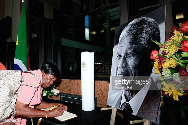 A woman signs a book of condolences to late South African President Nelson Mandela at the South African Parliament on December 10 2013 in Cape Town...