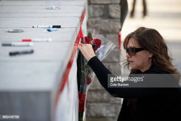 A woman signs a memorial card for the victims near the scene on Yonge St at Finch Ave after a van plowed into pedestrians on April 23 2018 in Toronto...