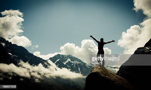 Woman Silhouette against Spectacular mountain landscape