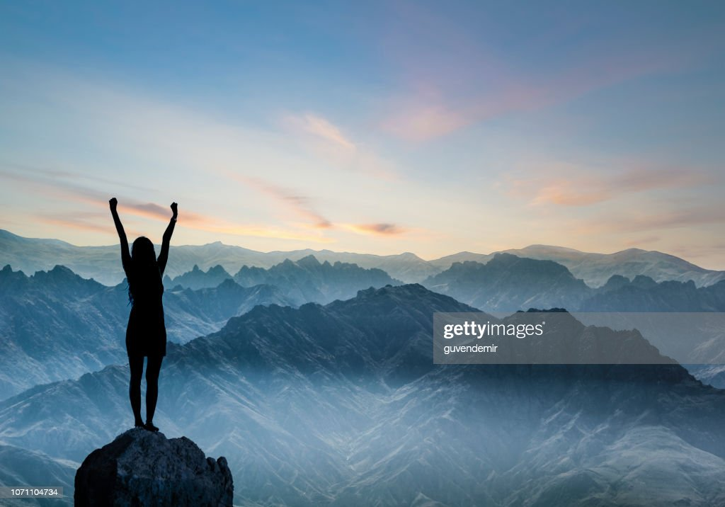 Woman Silhouette at sunset on hill : Stock Photo