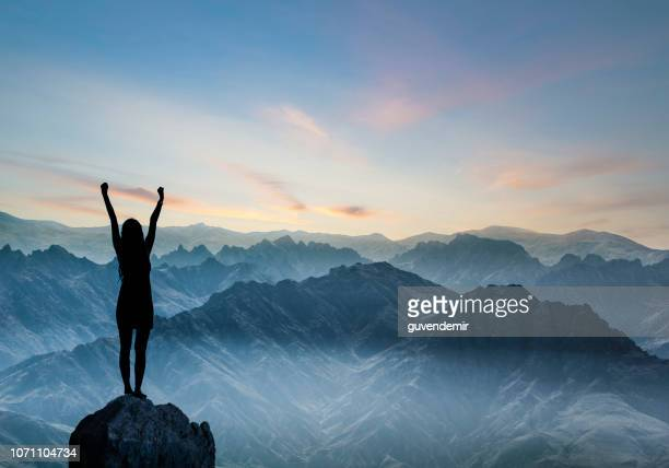 woman silhouette at sunset on hill - summit stock pictures, royalty-free photos & images
