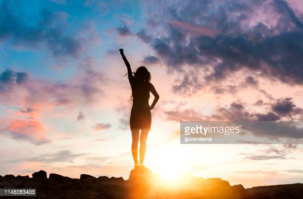 woman silhouette at sunset on hill - motivation stock pictures, royalty-free photos & images