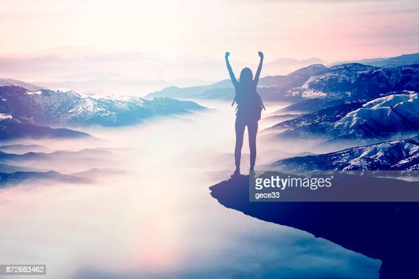 woman silhouette at sunset on hill - achievement stock pictures, royalty-free photos & images