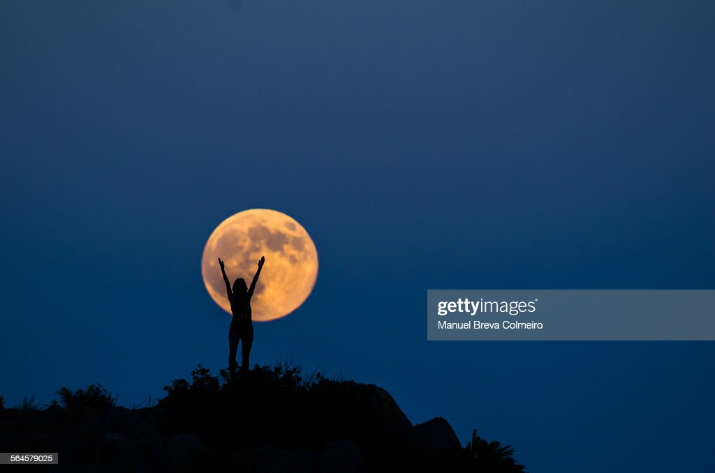 Woman silhouette on the full moon : Foto stock