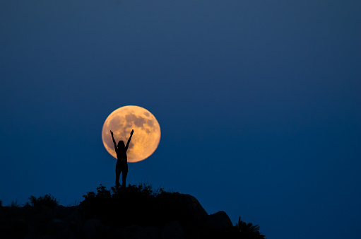 Woman silhouette on the full moon - gettyimageskorea