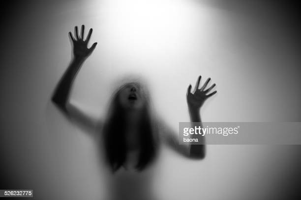woman silhouette - very scary monsters stock photos and pictures