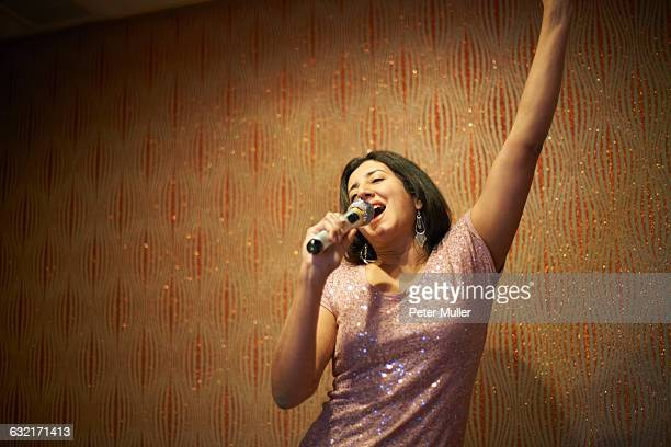 woman singing karaoke - one mature woman only fotografías e imágenes de stock