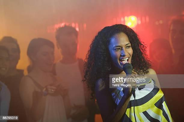 woman singing karaoke - karaoke stock pictures, royalty-free photos & images