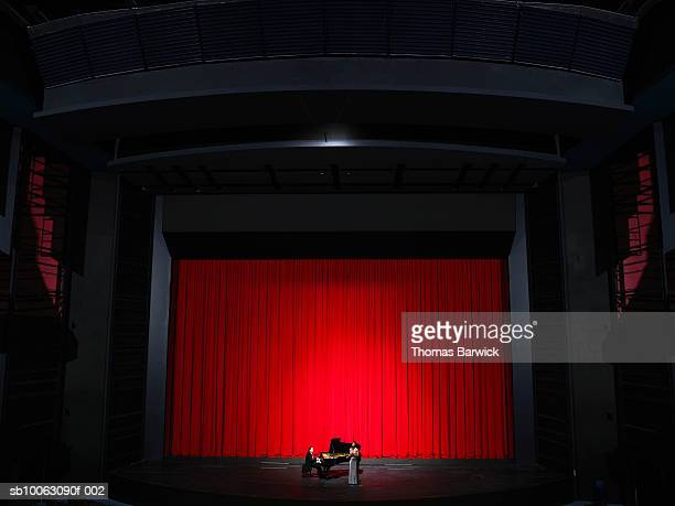 woman singing on stage accompanied by male pianist - opera singer stock pictures, royalty-free photos & images