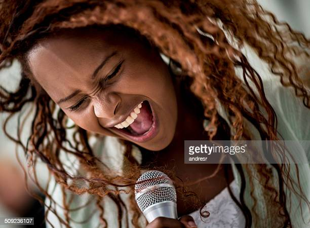 woman singing - entertainment occupation stock pictures, royalty-free photos & images