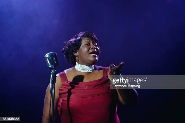 woman singing - soul music stock pictures, royalty-free photos & images