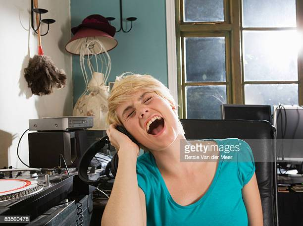 Woman singing to music.