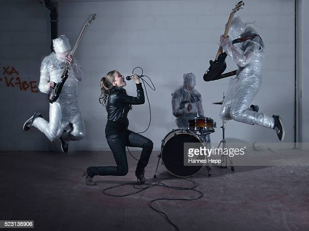 Woman Singing with Plastic Wrapped Band