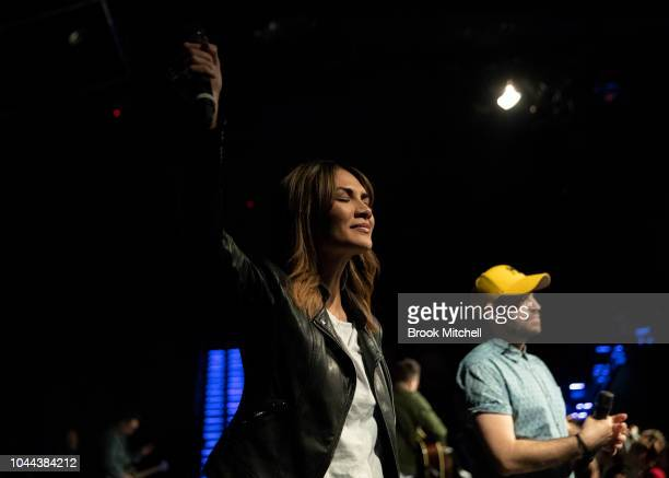 A woman sings on stage as part of a religious performance at the Horizon Church on September 29 2018 in Sydney Australia Horizon Church is a...