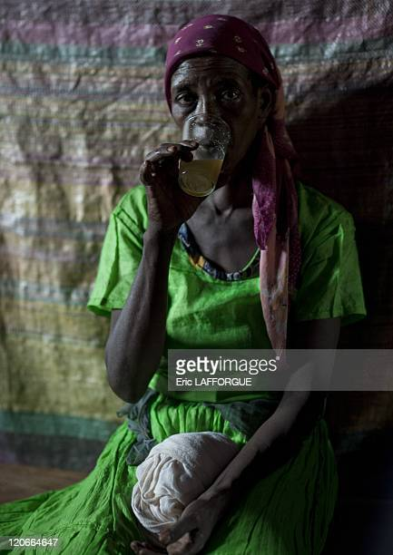 Woman sipping mead in a pub in Ethiopia on July 08 2010 Mead pub where men and women can drink mead which is made with honey water sugar and tedj You...