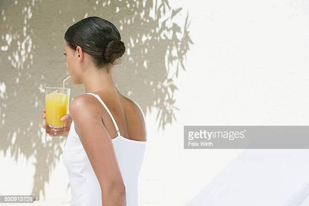 Woman sipping orange juice