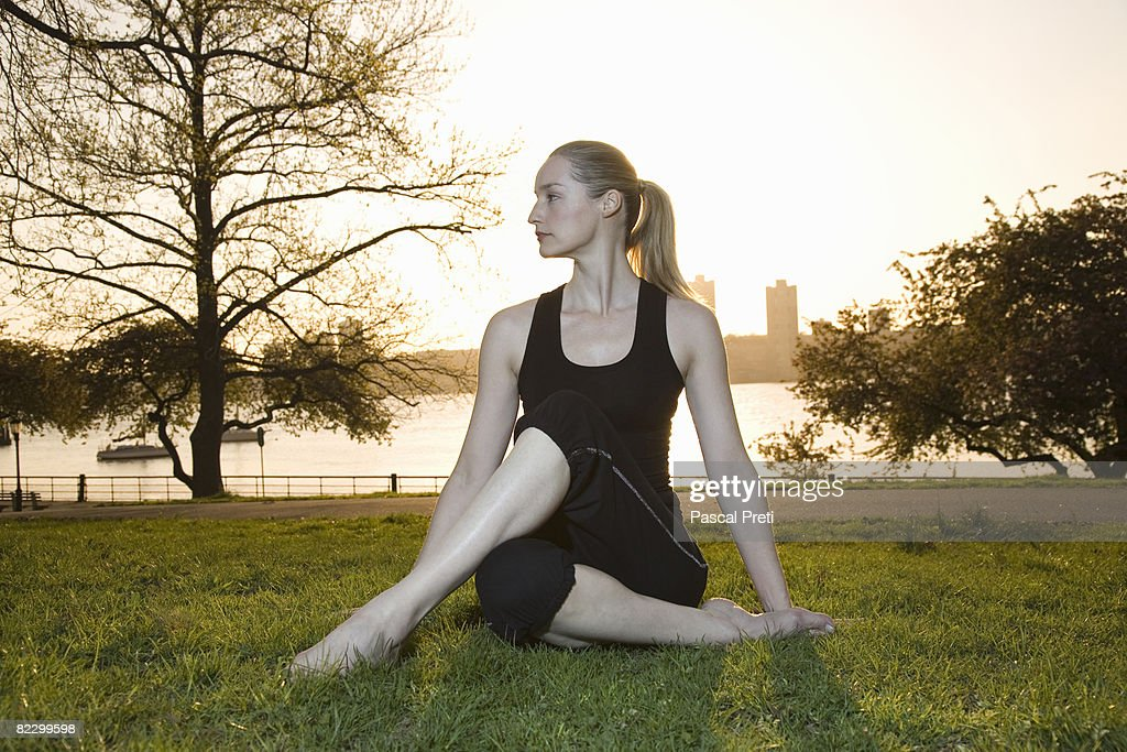 Woman siting in a yoga position : Stock Photo