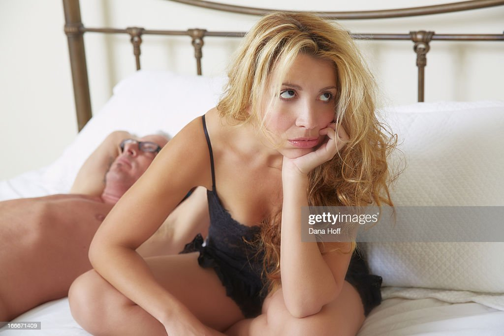 https://media.gettyimages.com/photos/woman-siting-on-bed-frustrated-picture-id166671409