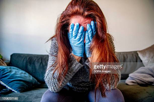 Woman sits at home in a stressful mood after testing positive of the covid-19 coronavirus. A 40 years old lady who doesn't want to be named has been...