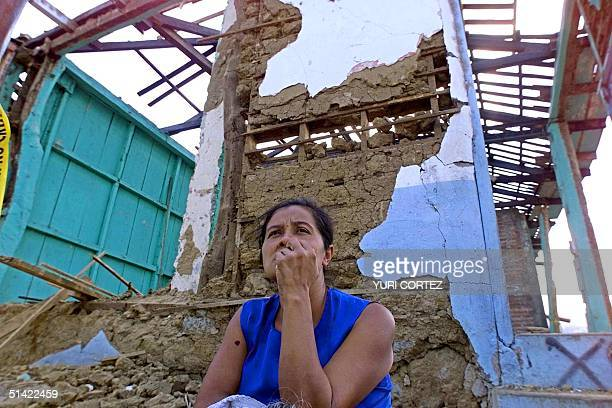 A woman sits before her earthquakedestroyed house 29 January 2001 in Armenia El Salvador 40kms west of San Salvador Salvadoran officials have warned...