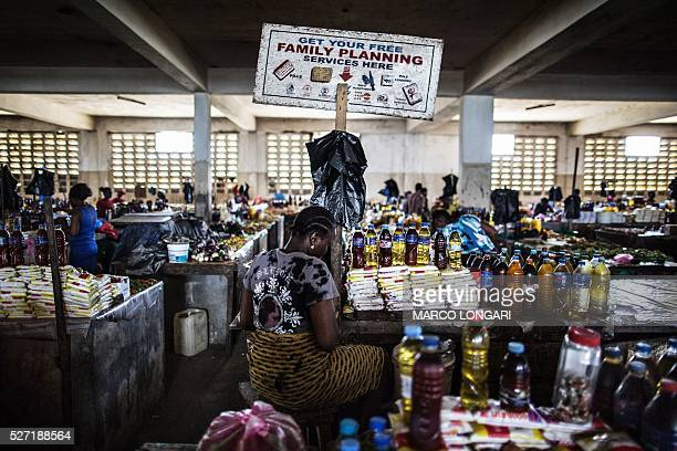 A woman sits by her stall in the Jorkpan market at Sinkor district in Monrovia on May 2 2016 Family planning services like contraceptives and...